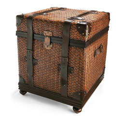 Frontgate - Granville Trunks - Large - Vintage tobacco-leather straps, corners, and handles provide handsome accents, as do hand-hammered nails and antiqued cast-metal latches and buckles. Prior to being wrapped in rattan, solid plywood frame is slightly padded to create softness. Trunks are set on handsomely turned bun feet. Leather undergoes several stages of hand-finishing. Use a small, soft brush or vacuum to prevent dust buildup on rattan. Our Granville trunks make for stylish storage or a handsome cocktail table, lending a tropical feel with their woven rattan. Artisans spend up to four days weaving the peel of this natural plant in an intricate herringbone pattern. Sturdy enough to sit on, each trunk features a hydraulic lift for soft closure as you insert or remove items.  .  .  .  .  . Imported .