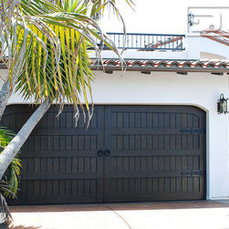 Custom Spanish Style Garage Doors Designed & Crafted in Orange County, CA! - Orange County, CA - Creating some of California's most attractive Colonial Garage Doors has been our forté for many years. Each time we custom design and craft a new garage door there's always room for innovation, recreation and culmination of our vast experience in combining our designer's architectural knowledge and our craftsmen skills in reviving these Colonial Style Doors from Spain.