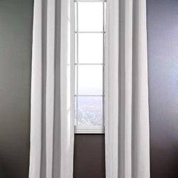 Heavy Linen Grommet Panels - These lovely linen panels have a contemporary edge provided by the large metal grommets around the rod holes. It's the small details like this that count.