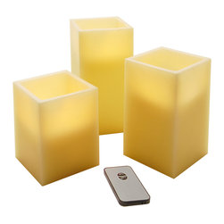 LumaBase Luminarias - Wax LED Remote Control Flickering Candles- Square- 3 Count - Highlight your home or event with these real wax flickering LED candles. These flameless candles provide warm amber light with a realistic flicker. Perfect to use on tabletops, windowsills or mantels.