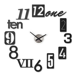 Numbers on the Wall Clock - A set of 12 metal stamp numbers come together to create a unique timepiece on your wall. Inspired by house numbers, each number has its own look and feel. Move them around to make the piece as big or as small as you want.