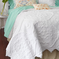 Our Favorite Knit Quilt - Inspired by the intricate quilting motifs found throughout Provence, this lovely quilt showcases grand-scale, richly textured floral medallions framed with fine diamond quilt stitching.
