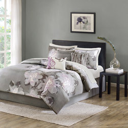 Madison Park - Madison Park Serena 200TC 7 Piece Comforter Set - Add a modern touch to your space with the Madison Park Serena Collection. This asymmetrical pattern features a charcoal grey base and watercolor floral design on one side that is also carried all-over on the shams. The face of this beautiful comforter features a 200 thread count cotton sateen fabrication for a matte look and crisp hand feel. A solid charcoal grey covers the cotton/poly reverse. Three decorative pillows use embroidery and fabric manipulation to provide additional details making this collection feel unique to your space. Comforter & Sham: 100% cotton, 200TC sateen printed on face, 132TC cotton/poly reverse, 270g/m2 poly fill Bedskirt: 132TC cotton/poly drop, non-woven fabric platform Pillow: cotton/poly cover and poly filling