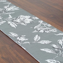 Chooty and Co Antebellum Graphite Table Runner - A stately addition to your dining decor, the Chooty and Co Antebellum Graphite Table Runner features a traditional floral pattern in pencil-sketch gray set against a graphite background. This handsome table runner is crafted of 100% pure cotton for color-safe durability. Made in the USA. Hand-wash or spot-clean.About Chooty & Co.A lifelong dream of running a textile manufacturing business came to life in 2009 for Connie Garrett of Chooty & Co. This achievement was kicked off in September of '09 with the purchase of Blanket Barons, well known for their imported soft as mink baby blankets and equally alluring adult coverlets. Chooty's busy manufacturing facility, located in Council Bluffs, Iowa, utilizes a talented team to offer the blankets in many new fashion-forward patterns and solids. They've also added hundreds of Made in the USA textile products, including accent pillows, table linens, shower curtains, duvet sets, window curtains, and pet beds. Chooty & Co. operates on one simple principle: What is best for our customer is also best for our company.