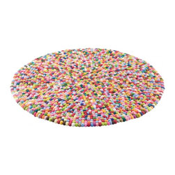 EcoFirstArt - Multi coloured pop rug round - If a gumball machine burst open, spilling its contents in a puddle, you have a visual sense for the surface and pattern of this striking rug. Thankfully for bare feet and crawling babies alike, this particular surface contains vibrant puffs, not hard candy. Handmade in Nepal, these wool balls are stitched together by artisans to create a playful carpet, bringing texture to your floor.