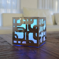 Artkalia - Kalis Mood LED Cube by Artkalia - A totally groovy mood light, baby. The Artkalia Kalis Mood LED Cube features a stainless steel case with a pattern of overlapping soft-cornered squares. This '60s-inspired motif is made even more psychedelic with the color-changing LED inside the water-resistant polyethylene cube. Makes a great accent light on tables indoors or out. Artkalia was founded in 2008 to combine energy efficient LED technology with attractive modern design. In order to make such design and efficiency accessible to as many people as possible, they have made their portable LED lighting affordable, fun and easy to use. Artkalia lighting designs enhance moods and indoor and outdoor spaces with their friendly, contemporary forms as well as their signature light color-changing technology.