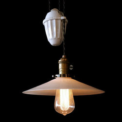 Porcelain Pulley Lights - Original antique rise and fall pulley lamps that have an early milk glass lamp shade, providing a soft light. The height is completely adjustable in a fun and interesting way. Imported from a private collection in Belgium.
