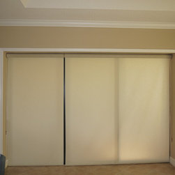 Window Treatments for Sliding Doors - Hunter Douglas's Designer Roller Shades work well on sliding doors.  The offer privacy or light control when needed, but roll up into a 3 1/2 in cassette for minimal intrusion into the opening.