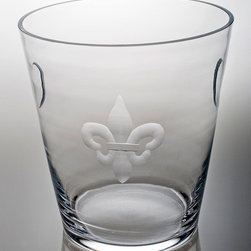 Fleur De Lis Clear Glass Ice Bucket - Formal purity of line marks the Fleur De Lis Clear Glass Ice Bucket as an elite accessory.  Whether you place it as a d�cor ative element or use it for its intended purpose to provide portable ice for beverages or chill a bottle of good wine, this weighty glass container with its ancient yet timeless heraldic symbol brings European interest to the home.