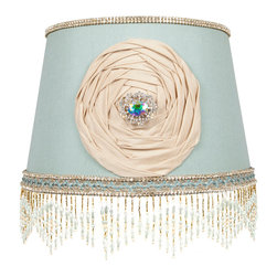 "Brandi Renee Designs - All Lit Up June's Delight Lamp Shade - We finished off our sophisticated eggshell blue lampshade with delicate gold and blue beading around the lamp base, creating a diamond fringe pattern. But the All Lit Up June's Delight lampshade's real eye-catching detail is the stunning ivory rosette with a beautiful ""jeweled"" centered. It's sure to be a showpiece in every room of the house. Like every BRDesign, our All Lit Up June's Delight lampshade is handcrafted from the finest quality materials."