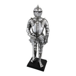 Silver Finish Medieval Knight In Armor Statue Figure Armour - This awesome decorative statue depicts a medieval knight in full armor, his left hand by his side, his right hand resting on his sword. The detailing is exquisite, with intricate designs on his breastplate and leg armor. Made of cold cast resin, the statue measures 13 inches high, 4 1/2 inches long, and is 3 inches wide.