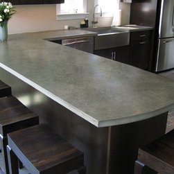 Custom Concrete Countertops - These days, concrete is more than just an industrial flooring option.  Trueform elevates this natural product to elegant heights, highlighting the mottled surface with a gentle sheen and adding a sophisticated edge to any kitchen.