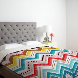 DENY Designs - DENY Designs Khristian A Howell Nolita Chevrons Duvet Cover - 13003-DUWKIN - Shop for Duvets from Hayneedle.com! Style your comfy bed with the eye-catching design of the DENY Designs Khristian A Howell Nolita Chevrons Duvet Cover. Machine washable this ultra-soft duvet cover is made of 100 percent polyester microfiber material that features small metal snaps that ensure a secure closure around any bed. Three different size options are available.About DENY DesignsDenver Colorado based DENY Designs is a modern home furnishings company that believes in doing things differently. DENY encourages customers to make a personal statement with personal images or by selecting from the extensive gallery. The coolest part is that each purchase gives the super talented artists part of the proceeds. That allows DENY to support art communities all over the world while also spreading the creative love! Each DENY piece is custom created as it's ordered instead of being held in a warehouse. A dye printing process is used to ensure colorfastness and durability that make these true heirloom pieces. From custom furniture pieces to textiles everything they make is unique and distinctively DENY.