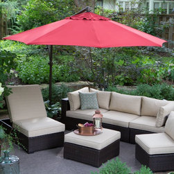 "Treasure Garden - Treasure Garden 10 ft. Cantilever Octagon Offset Patio Umbrella - AG19-00-4807 - Shop for Patio Umbrellas from Hayneedle.com! Save yourself from sweltering sunshine with the Treasure Garden Cantilever 10-ft. Octagon Tilt and Lock Offset Umbrella. A popular choice for covering conversation seating or large dining sets this cantilever patio umbrella casts a generous 79 square feet of shade. The offset pole is made of aluminum and covered in a powder-coated finish for protection. The crank-style lift and locking tilt mechanisms make it easy to adjust the height and angle of your umbrella. Simply add weights to the cross-bar stand for stability. Choose from a variety of colors in high-performance O'bravia fabric to fit your outdoor setting. Additional Features: 8 ribs measure 14 x 20mm each and support octagon shade Single-vented shade reduces effects of wind gusts Pole diameter: 2.7 inches Height closed: 86.3 inches About O'bravia FabricSpecially designed for outdoor applications O'bravia fabric is a stain-resistant high-performance environmentally friendly fabric. A proprietary blend of recyclable 100% solution-dyed polyester the fabric is a truly ""green"" choice for patio umbrellas cushions and other accessories. O'bravia fabric meets or exceeds all industry requirements including UV abrasion and Cal 117 standards. It carries a 3-year warranty against fading from normal usage and exposure to weather and atmospheric conditions including sunlight and mildew."