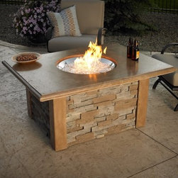 "Outdoor GreatRoom Sierra Gas Fire Pit Table - The Outdoor GreatRoom Sierra Gas Fire Pit Table blends the beauty of nature with the innovation of science to bring your patio the best of both worlds. The natural brown super cast table top blends perfectly with any outdoor setting and holds the stainless steel fire pit in its center, boldly showing off the rugged yet sophisticated fire. Adjust the flame from your gas tank to watch it dance on top of the tempered, tumbled glass at varying heights.Burning at 60,000 BTU's, this fire pit runs off of LP gas but is easily converted to a natural gas fire pit. Avoid deterring from this pieces beauty by placing your gas tank in its concealed compartment. To ensure you've got the perfect centerpiece for your deck, patio, or backyard, this fire pit is customizable with any of three bowl shapes.Circular bowl: 20-inch diam.Rectangular: 12L x 24W inchesSquare: 24L x 24W inchesAbout Outdoor GreatRoom CompanyWith over 50 patents to its name, the Outdoor GreatRoom Company is one of the most innovative names in gas fireplaces and outdoor design, period. Since 1975, Dan, Ron, Steve, and Ger have produced a yard of amazing products, like the Heat-N-Glo, that have changed the industry. In fact, they want to change the way you think about your backyard or patio. It's about bringing the luxury and comfort of the living room outside to make an """"Outdoor Room."""" They want you to, literally, think outside the box. To make that beautiful concept a reality, Outdoor GreatRoom designs, manufactures, and sells pergolas, outdoor kitchens, grills, outdoor furniture, fireplaces, fire pits, lighting, and heating products. There's no better name in outdoor leisure than this fine Minnesotan company."