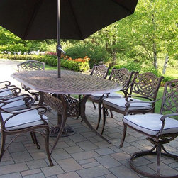 Oakland Living - Mississippi 9-Pc Oval Traditional Patio Dinin - Includes one table, six dining chairs with cushions, two swivel chairs with cushions, umbrella and umbrella stand. Fade, chip and crack resistant. Traditional lattice pattern and scroll work. Brass hardware. Warranty: One year limited. Made from rust free cast aluminum. Hardened powder coat finish in antique bronze. Minimal assembly required. Table: 84 in. L x 42 in. W x 29 in. H. Dining chair: 23 in. W x 22 in. D x 35.5 in. H (23 lbs.). Swivel chair: 23 in. W x 17.5 in. D x 38 in. H (66 lbs.). Umbrella: 108 in. L x 108 in. W x 100 in. H (45 lbs.)This dining set is the prefect piece for any outdoor dinner setting. Just the right size for any backyard or patio. The Oakland Mississippi Collection combines southern style and modern designs giving you a rich addition to any outdoor setting.