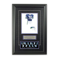 """Heritage Sports Art - Original art of the NFL 1976 Seattle Seahawks uniform - This beautifully framed piece features an original piece of watercolor artwork glass-framed in an attractive two inch wide black resin frame with a double mat. The outer dimensions of the framed piece are approximately 17"""" wide x 24.5"""" high, although the exact size will vary according to the size of the original piece of art. At the core of the framed piece is the actual piece of original artwork as painted by the artist on textured 100% rag, water-marked watercolor paper. In many cases the original artwork has handwritten notes in pencil from the artist. Simply put, this is beautiful, one-of-a-kind artwork. The outer mat is a rich textured black acid-free mat with a decorative inset white v-groove, while the inner mat is a complimentary colored acid-free mat reflecting one of the team's primary colors. The image of this framed piece shows the mat color that we use (Medium Blue). Beneath the artwork is a silver plate with black text describing the original artwork. The text for this piece will read: This original, one-of-a-kind watercolor painting of the 1976 Seattle Seahawks uniform is the original artwork that was used in the creation of this Seattle Seahawks uniform evolution print and tens of thousands of other Seattle Seahawks products that have been sold across North America. This original piece of art was painted by artist Bill Band for Maple Leaf Productions Ltd. Beneath the silver plate is a 3"""" x 9"""" reproduction of a well known, best-selling print that celebrates the history of the team. The print beautifully illustrates the chronological evolution of the team's uniform and shows you how the original art was used in the creation of this print. If you look closely, you will see that the print features the actual artwork being offered for sale. The piece is framed with an extremely high quality framing glass. We have used this glass style for many years with excellent results. We pa"""