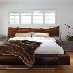 Residence 8 - Bed - Headboard made from natural Acacia wood.  Rests on Espresso Cowhide wrapped frame with Steel Legs.
