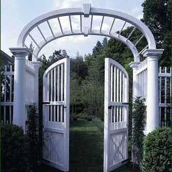 Elliptical Arbor - A custom spindle top elliptical Arbor with keystone pleasantly surprises with a choice of supporting columns instead of square posts. Magnificently curved custom double gates follow the lines of the arch.