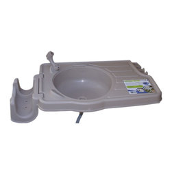 Riverstone Industries - Outdoor Garden Sink Large - Outdoor Garden Sink Large - Affordable portable outdoor sink program in the market today. The RSI-S2 larger area work surface sink is a great sink that allows within minutes a fully function sink to be installed outdoors, all that is needed is a standard garden hose. With the Riverstone outdoors sink you can keep the dirt out of the house. Whether using it to clean dirt off shoes or boots, garden tools, paint brushes, kids hands, cleaning vegetables and herbs from your garden, or just about anything you need to clean the Riverstone Sink works great. This is also a perfect sink for cleaning and scaling fish. The large surface area allows for this coupled with the built in tool storage make this a great alternative to an indoor sink. The detachable hose reel holds up to 200 ft of garden hose. Features: Large sink and work area. Built in tool storage. Outdoor garden sink/watering station. Comes with mounting hardware, drain tube, and nozzle holder. Great for washing hands, cleaning fish. Quick set-up. Soap area built in. Drainage hose included. Holds up to 200 ft of garden hose. Makes washing fruit or vegetables outside easy. Made from durable plastic. Hose and nozzle sold separately. upward motion. Features: Outdoor garden sink/watering station. Comes with mounting hardware, drain tube, and nozzle holder. Great for washing hands. Quick set-up. Soap area built in. Drainage hose included. Holds up to 100 ft of garden hose. Makes washing fruit or vegetables outside easy. Made from durable plastic. Hose and nozzle sold separately.