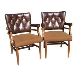 Used Mid-Century Modern Walnut Office Chairs - A Pair - These chairs are made from a solid walnut frame with a rich, burnished finish to the wood. They feature a square back, upholstered in deep brown vinyl with tufted button detail. It has double arm rests in matching deep brown vinyl with a second pair in solid walnut below. The seats are upholstered in fabulous olive green wool with brown trim. They have brass nailhead trim for an elegant finish, and are in good vintage condition.