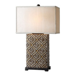 Uttermost - Uttermost 26829-1  Curino Golden Bronze Table Lamp - Relief detail finished in a golden bronze stain with silver champagne accents and rustic black details. the rectangle box shade is a silken golden champagne fabric.
