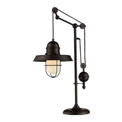 Farnhouse Table Lamp - This Farmhouse Lamp recalls turn-of-the-century design where simple aesthetics and mechanical function combined to create charming, yet versatile light fixtures. The classic pull-downs have a decorative weight to counterbalances the fixture for easy height adjustment by simply pulling down or lifting up on the fixture.