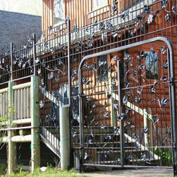 Functional Metal Art, Wrought iron - Privacy fence with gate.  Earth Eagle Forge