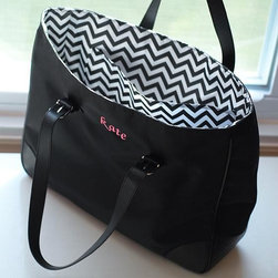 Home Decorators Collection - Personalized Chevron Buckle Tote - Our Personalized Chevron Buckle Tote features an easy-to-clean microfiber finish in black and a contemporary black and white chevron lining. Two faux leather straps with buckle closures and an interior pocket round out this tote's fashionable marriage of form and function. Constructed of easy-to-clean microfiber. May be embroidered with a name in lowercase (up to 15 characters) or an encircled block monogram at no extra cost. Fonts as shown only.