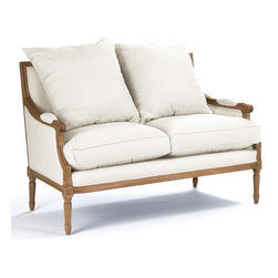 Kathy Kuo Home - St. Germain French Country Natural Oak Louis XVI White Settee - Overstuffed cushions lend an informal touch to this elegant Louis XVI style settee. Upholstered in off white linen, its natural oak frame and fluted legs are embellished with decorative carvings. Set of 2 pillows included.