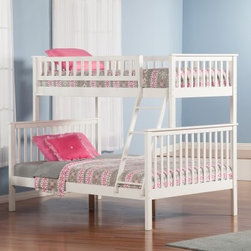 Woodland Twin over Full Bunk Bed - A timeless design and several finish options make the Woodland Twin over Full Bunk Bed just right for your child's bedroom. This bunk bed features a popular twin over full design. It's made of strong hardwoods and includes a 14-piece slat kit. You may set up the ladder at either end; it's securely attached for safety. Create a customized bunk bed by adding on any of the optional underbed storage or trundle pieces. All have the same sturdy construction and come in matching finish options.About Atlantic FurnitureFounded in 1983 as Watercraft, Inc., Atlantic Furniture started as a manufacturer of pine waterbed frames. Since then, the Springfield, Mass.-based company has expanded to Fontana, Calif. The company has moved away from the use of pine and now specializes in imported furniture made of the wood of rubber trees.The Benefits of Eco-Friendly RubberwoodPrized as an environmentally friendly wood, rubberwood makes use of trees that have been cut down at the end of their latex-producing life cycle. Originally native to Thailand, the trees are removed by hand and replaced with new seedlings. In the past, felled rubber trees were either burned on the spot or used as fuel for locomotive engines, brick firing, or latex curing. Now the wood is used in the manufacture of high-end furniture. It is valued for its dense grain, stability, attractive color, and acceptance of different finishes.Atlantic's Unique Five-Step Finishing ProcessEach product in the entire line is finished with a high-build, five-step finishing process. After a thorough sanding, a wipe-on sealer is applied, followed by a tinted sealer to even the grain and color of the wood. Additional sanding prepares the surface for the first base color coat, more sanding, and a second base color coat. After a final sanding, the finish coat is applied. This process produces a beautiful and durable finish that will last for years.