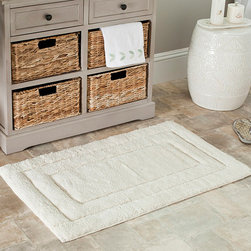 Safavieh - Spa 2400 Gram Tri Natural Gram 27 x 45 Bath Rug (Set of 2) - This set of two luxurious bathroom mats will give your room the feel of a spa. Each mat features a natural color and an extra-dense design that will feel comfortable under your feet. A latex backing on the rugs will help prevent any accidental slips.