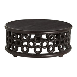 "Arteriors - Kamal Cocktail Table - Staggered solid hand carved ""circles"" support the wood top and connect it to the borrom ring resulting in a dark walnut cocktail table that nods to tribal influences."