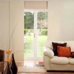 Blinds.com Solid Vinyl Sliding Panels - Sliding panel shades are popular for large windows and walls of glass. These panel tracks are also perfect for patio sliders and sliding doors, or even as a room divider. The most popular Room Darkening colors are available.