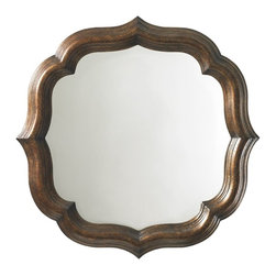 Tommy Bahama - Tommy Bahama Royal Kahala 38 Round Lotus Blossom Mirror - As the name implies the elegant shaping reflects the tropical flower.  While Royal Kahalas design theme reflects a Pan-Asian sensibility the sophistication of the lifestyle is found in the mix of eclectic design influences - Ivory Coast British Campaign and Colonial Caribbean and Safari. The collection evokes a sense of romance and intrigue through the convergence of diverse design elements exotic materials and rich finishes. The Tommy Bahama brand is known for its ability to capture the essence of inspired destination living and translate that lifestyle through distinctive furnishings into a consumers home decor. Royal Kahala designs are crafted from Ribbon Stripe and Quarted Mahogany in a rich dark Kona finish. Select items are styled in leather-wrapped split rattan and finished in an exotic Tortoise Shell finish. Other natural materials include Penn Shell split bamboo sugar cane nail-trimmed leather Coco Shell woven wicker and Raffia. Custom hardware is finished in antique brass with and aged patina. A signature item in the collection is a mirrored night stand with custom pulls made of Australian Blacklip Abalone Shell. This remarkable shell features an iridescent mother of pearl inner surface with a distinctive black lip around the outer edge making an elegant statement. The Tommy Bahama Furniture brand is legendary for its sophisticated interpretation of inspired island living. We believe that experiencing the casual comfort of the islands should be as easy as walking through your own front door. The Tommy Bahama Home furniture collection of distinctive furnishings evokes a sense of romance and intrigue through the fusion of eclectic design exotic natural materials and rich finishes. We invite you make life one long weekend and capture the essence of resort living with the cool and casual style of Tommy Bahama. Tommy Bahama by Lexington Home Brands is a global manufacturer and marketer of 