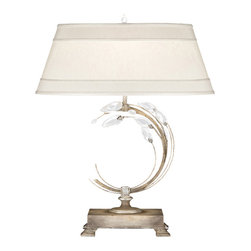 Fine Art Lamps - Crystal Laurel Silver Table Lamp, Left-side Facing771510ST - The laurel wreath was a status symbol in classical times and has since become one of the most enduring design motifs in history. This striking table lamp gives the motif a contemporary update, with a stylized laurel bow hand-crafted from your choice of gold- or silver-leafed metal with faceted crystal leaves. Stylishly topped with a horizontal shade and crystal finial, this laurel crescent lamp is sure to impress.