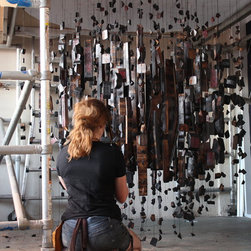 Wine Stave Chandeliers - Anna strings the pieces of the 'exploding wine barrel' together in dozens of drops.