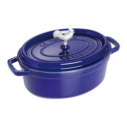 Staub - Staub Coq au Vin Cocotte 4.25 qt. - Dark Blue - 1122991 - Shop for Baking & Roasting Dishes from Hayneedle.com! The Staub Coq au Vin Cocotte 4.25 qt. - Dark Blue is the perfect choice for preparing traditional French cuisine. Constructed of cast iron this incredibly durable pan features an extra-heavy lid that seals moisture in and dozens of well-placed spikes that continuously baste the pans contents ensuring your dish retains the full flavor of each ingredient. When it's time for clean up simply pop this pan into the dishwasher. The high-quality enamel coating resists scratches and will never discolor.About Staub CookwareFrom professional chefs to home cooks people with a passion for cooking rely on Staub cookware. Combining the utility of cast iron with the latest technology available Francis Staub designed his first enameled pot in 1974 in the Alsace region of France. Known for performance style and durability Staub has become the benchmark for enameled cast-iron cookware. Ideal for braising searing roasting and caramelizing food Staub's signature pots - called cocottes - feature an enameled interior with a matte black finish. Resistant to rust chipping and cracking cocottes are available in round and oval shapes in a variety of sizes and colors. Just right for slow-cooking food Staub cocottes are designed to provide even heat distribution excellent heat retention and continuous self-basting. The inside of each heavy snug-fitting lid features a series of bumps (or self-basting spikes) to allow continuous natural basting by distributing moisture throughout for extra flavor and tenderness. In addition to its signature cookware which is perfect for serving at the table Staub also offers pans for frying sauteing grilling and roasting as well as a variety of teapots accessories and gourmet specialty items.