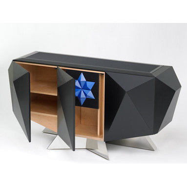 Eco Friendly Furnture and Lighting - Blue Star Credenza.FSC certified maple ply, low VOC finish, back painted glass inset top, solid FSC maple dovetailed drawers, polished stainless steel, Padauk and Narra inlays. The constellation of Orion and the star Sirius figures prominently in the belief systems of the Dogon tribe of Africa and the mysterious Hopi tribe of the American South-West. In addition to architectural similarities between these peoples (i.e. the construction of dwellings on the sides of cliffs) the Dogon and Hopi also share traditions suggesting ancient connections to the pyramid builders of Egypt and the Mayan Peninsula respectively. It was the contemplation of these and other unusual parallels between these two peoples which laid the foundation for the design of this credenza. The 3 stars of Orion's belt inspired the configuration of doors, which are each raised pyramids in design. Behind the center door is a bank of 4 drawers, each of which opens by way of a pneumatic touch latch motorized mechanism. A single adjustable shelf is located behind each of the outer doors. The top is an inset of back painted glass. The back is fully finished, and inlaid with a raised relief. The convex inlay representing Sirius is made of a wood called Narra. The particular selection of wood used to make this inlay carries a special provenance in the world of sustainable forest management, in that this actual inlay comes from the last remaining board known to exist of the very first wood to be sustainably harvested on the Solomon islands in the early to mid 1990s. This wood made its way into North America by way of Eco-Timber in California. This credenza been made as an edition of 1 of 1, and will not be duplicated. It is individually numbered and signed