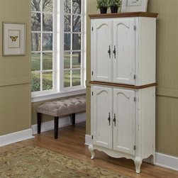 HomeStyles - Oak and Rubbed White Pantry - The pantry is constructed of hardwood solids and engineered wood in a distressed oak and heavily rubbed white finish. The distressed oak features several distressing techniques such as worm holes, fly specking, and small indentations. Features include four cabinet doors with adjustable shelving and detailed brass hardware. Shelves are adjustable to accommodate over-sized cereal boxes. Assembly required. 30.25 in. W x 17 in. D x 71 in. H