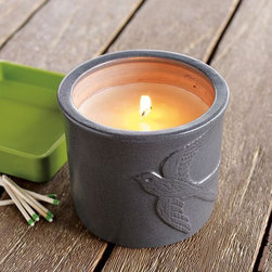 Carter & Cunningham Candle Pot - This gray, ceramic citronella candle pot—designed exclusively for west elm by Mark Welsh and James Salaiz, of Manhattan design studio Carter & Cunningham—features a soaring swallow in sculptural relief. Because it's filled with citronella, it's perfect for placing on picnic tables and patios to get bugs to buzz off.