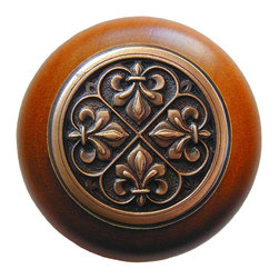 "Inviting Home - Fleur-de-Lis Cherry Wood Knob (antique copper) - Fleur-de-Lis Cherry Wood Knob with hand-cast antique copper insert; 1-1/2"" diameter Product Specification: Made in the USA. Fine-art foundry hand-pours and hand finished hardware knobs and pulls using Old World methods. Lifetime guaranteed against flaws in craftsmanship. Exceptional clarity of details and depth of relief. All knobs and pulls are hand cast from solid fine pewter or solid bronze. The term antique refers to special methods of treating metal so there is contrast between relief and recessed areas. Knobs and Pulls are lacquered to protect the finish. Alternate finishes are available. Detailed Description: The Fleur-de-lis means ""flower of the lily"" It was used to represent French royalty. It was said that the king of France Clovis who started using the symbol of the Fleur-de-lis because the water lilies helped guide him to safety and aided him in winning a battle. The design in the Fleur-de-Lis pulls is arranged in alternating positions of the Fleur-de-lis. These pulls are a great match for the Fleur-de-lis knobs which have the Fleur-de-lis pattern arranged in a circle. The different shapes of decorative hardware make the cabinet doors and drawers interesting to look at."