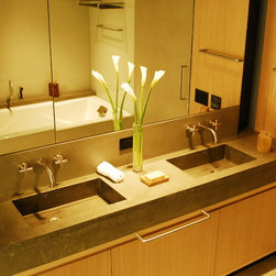 Concrete bathroom countertop with double sink - Polished concrete sinks. photos by Jules Helm