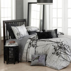 Vue Twilight 3 pc. Comforter Set - As night falls, nature is backlit and shadows dance across the Vue Twilight 3 pc. Comforter Set. The soft gray background features a bold, stenciled pattern of black flowers for a distinctive, modern appeal. The reversible design is machine-washable for easy care, and is certain to make your bed an inviting retreat you'll love to crawl into after a long day.Comforter Dimensions:Queen: 96L x 90W in.King: 96L x 106W in.Pillow Sham Dimensions:Queen: 20L x 26W in.King: 20L x 36W in.