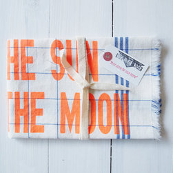 """Tea Towel by Knife in the Water - The screen-printed neon orange letters pop on this linen tea towel. The text reads, """"live by the sun, love by the moon."""""""