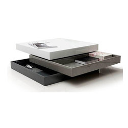 MODERN SWIVEL COFFEE TABLE WITH STORAGE KANU - Modern transforming square coffee table with storage Kanu has two swivel pieces that launch two storage sections beneath each part of the coffee table. This contemporary occasional coffee table has got a triple lacquered surface with glossy color.