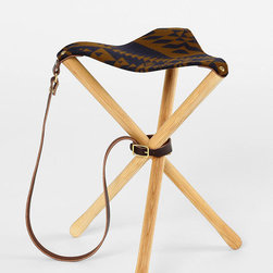 Pendleton Thomas Kay Camp Stool - This unique wooden camp stool is topped with a graphic woolen Pendleton seat and has an attached leather strap for easy toting.