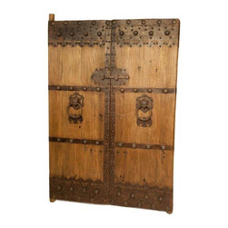 Antique Wooden Gate Doors - Make a monumental statement with this majestic set of two original antique Chinese wooden gate doors. Each door features metal pulls with a working closure on back. The doors are about 80 to 100 years old, sure to add a historical presence to your decor.
