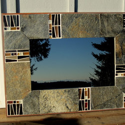 Bogart - A custom designed, handcrafted mirror that combines a silver gray slate with a gilded glass tile mosaic in shades of silver, gold, amber, black and brown. The effect is decidedly masculine and is reminiscent of the golden age of film, hence the name. I would be wonderful hung in a library, boardroom, office, bathroom or any room where drama is desired.