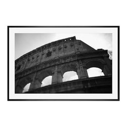 """Michal Venera Framed Print, Coliseum I, Mat, 28 x 42"""", Black - On first glance, these iconic images of Rome are striking for their lush sepia tones, rich detail and intriguing camera angles. A closer look reveals the beauty of patterns, whether it is hundreds of stones that make up an old street, arches in the coliseum or the remaining three columns of a ruin. All exude a sense of order and timelessness amid the ever-changing landscape of city and country. 13"""" wide x 11"""" high 20"""" wide x 16"""" high 42"""" wide x 28"""" high Alder wood frame. Black or white painted finish; or espresso stained finish. Beveled white mat is archival quality and acid-free. Available with or without a mat.{{link path='shop/accessories-decor/pb-artist-gallery/artist-gallery-michal-venera/'}}Get to know Michal Venera.{{/link}}"""